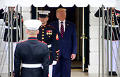 United States President Donald J. Trump stands under the awning out of the rain as he waits to welcome the President Sergio Mattarella of the Italian Republic at the South Portico of the White House in Washington, DC on Wednesday, October 16, 2019.<br /> Credit: Ron Sachs / CNP