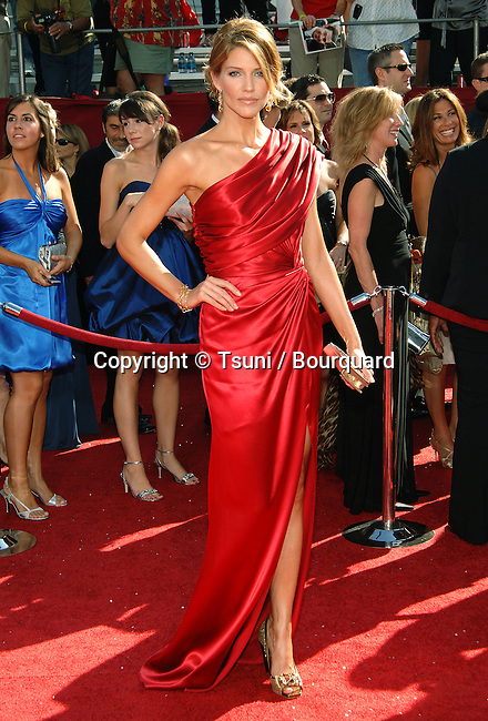 Tricia Helfer    - <br /> 60th Annual Emmys Awards at the Nokia Theatre in Los Angeles<br /> <br /> full length<br /> eye contact<br /> smile    -
