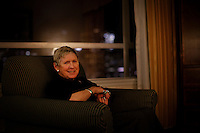 "San Francisco, California, January 5, 2011 - A portrait of Linda Sharp in her hotel suite the night before her Interventional MRI (or iMRI) surgery at University of California San Francisco Medical Center. Ms. Sharp was diagnosed with Parkinson's disease about ten years ago and has steadily seen her condition decline. She says that she read everything she could on the subject and decided to try the iMRI at the suggestion of her neurologist, Dr. Chad Christine, a doctor at UCSF. Her PD has progressed to a point where the movement disturbances could no longer be alleviated with medication. She says she is hopeful about the surgery. ""I just want my quality of life back."" She added that she misses going out to dinner with her husband, taking walks along the beach where she lives and being able to read before going to bed. The procedure does not cure the disease, but should alleviate the symptoms for 7-10 years giving Ms. Sharp the opportunity to regain some of these simple pleasures. ..The iMRI procedure uses Deep brain stimulation (DBS), which has been used for over a decade to treat movement disorders such as Parkinson's disease, essential tremor, and dystonia. DBS uses a pulse generator implanted in the chest, similar to a pacemaker, to deliver pulses to specific regions of the brain via a permanently implanted electrode. In the U.S., DBS is normally done while the patient is awake, because the surgeon needs to induce the symptoms (like the involuntary movements of Parkinson's) to know if he's in the right place, and if the patient is unconscious, the symptoms can't be induced. Many patients find it hard to tolerate. Their head is clamped in a frame, they're aware of their surroundings, and the surgeon is deliberately producing tremors and twitches while they lie there...Interventional MRI (or iMRI) allows surgeons to implant these electrodes while the patient is unconscious taking advantage of MR imaging in real time."