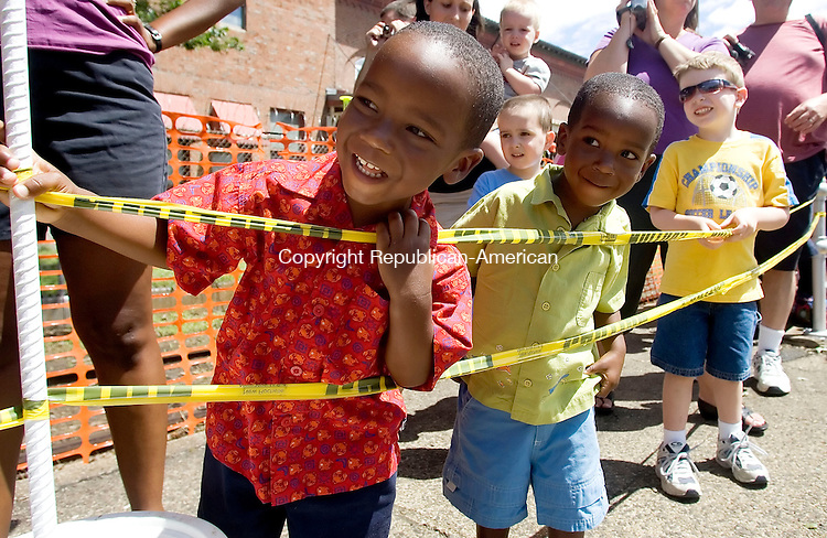 WATERBURY, CT- 04 AUGUST 06- 080406JT02-<br /> Twins Reuben and Aaron Williams, 2, of White Plains, NY, and Daniel Moseley, 5, of Farmingdale, NY, react as they first see Thomas the Train approaching the Waterbury train station on Meadow Street on Friday.<br /> Josalee Thrift Republican-American