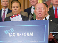 "United States Representative Kevin Brady (Republican of Texas), Chairman, US House Ways and Means Committee, shows off a card with ""simple, fair 'postcard' tax filing"" as he makes remarks as US Senate and House Republicans announce their new tax plan endorsed by US President Donald J. Trump in the US Capitol in Washington, DC on Wednesday, September 27, 2017. Photo Credit: Ron Sachs/CNP/AdMedia"