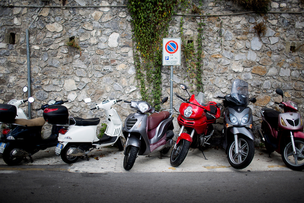 Scooters sit parked along a tight road on Sunday, Sept. 20, 2015, in Positano, Italy. (Photo by James Brosher)