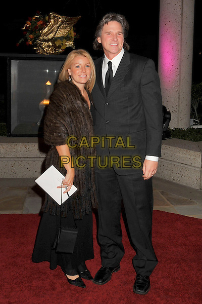 GUEST & BILLY DEAN.BMI's 56th Annual Country Awards held at BMI Music Row, Nashville, Tennessee, USA..November 11th, 2008.full length black suit dress brown fur wrap coat jacket .CAP/ADM/LF.©Laura Farr/AdMedia/Capital Pictures.