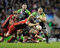 Mike Brown of Harlequins surges upfield during the Aviva Premiership match between Harlequins and Saracens at Twickenham on Tuesday 27 December 2011 (Photo by Rob Munro)