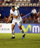 Abby Wambach heads the ball. The US Women's National Team defeated Haiti 5-0 during the CONCACAF Women's World Cup Qualifying tournament at Estadio Quintana Roo in Cancun, Mexico on October 28th, 2010.