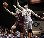 SIOUX FALLS, SD: MARCH 22:   Ryan Quaid #22 of West Texas A&M shoots past Zach Hankins #35 of Ferris State during their game at the 2018 Division II Men's Basketball Championship at the Sanford Pentagon in Sioux Falls, S.D. (Photo by Dick Carlson/Inertia)