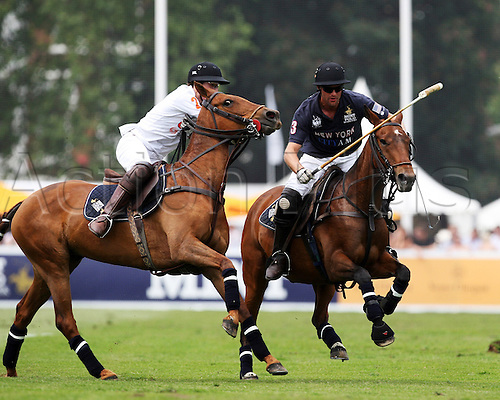 JAmie Morrison of New York and Martin Luginbuhl of Geneva swing for the ball during the semifinal New York v Geneva during the MINT Polo in the Park, London leg of the World Series, at Hurlingham Park in London, England on June 5, 2010.