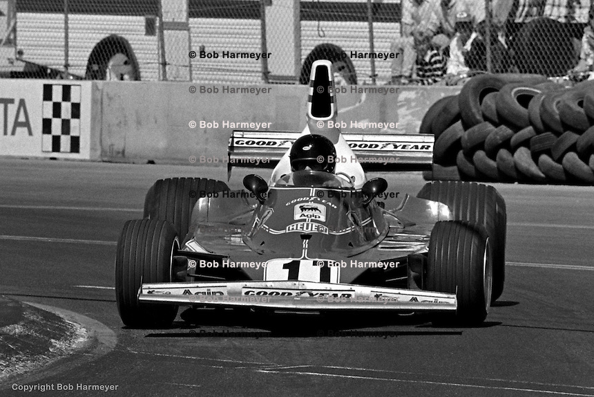 LONG BEACH, CA: Phil Hill takes a test run in a Ferrari 312T before the inaugural United States Grand Prix West on March 28, 1976, on the temporary street circuit in Long Beach, California.
