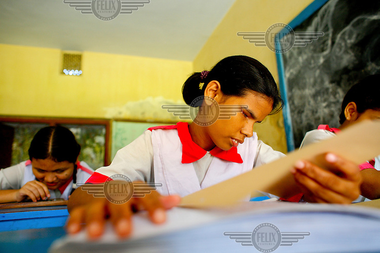 A girl reads braille at the Baptist Sangha School for Blind Girls. This place remains the only specialised residential school for blind girls in Bangladesh. At present, the school - directed by Bangladesh Baptist Church Sangha - that started with only five students, houses and educates about 70 girls, hailing from the least-privileged quarters of society.