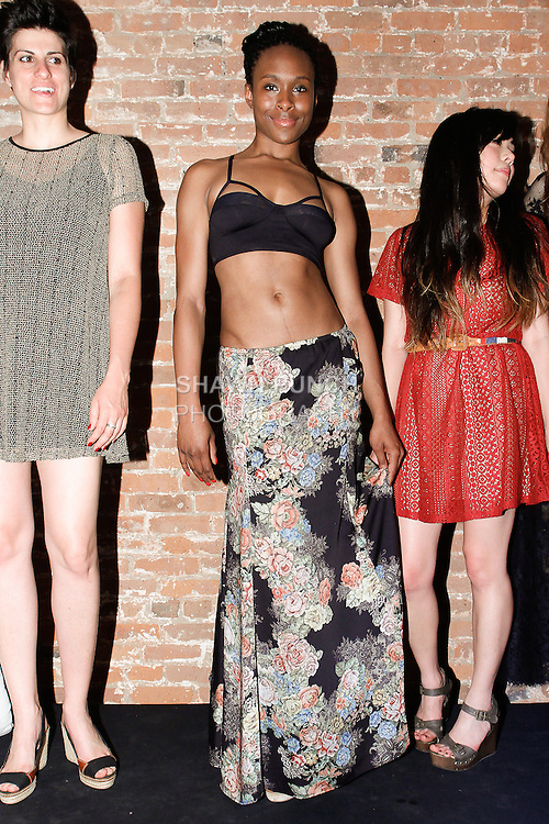 Models pose in outfits from the Only Hearts collection by Helena  and Kaya Stuart, during the inaugural Wear New York Fashion Week presentation at 393 Broadway on June 27, 2013.