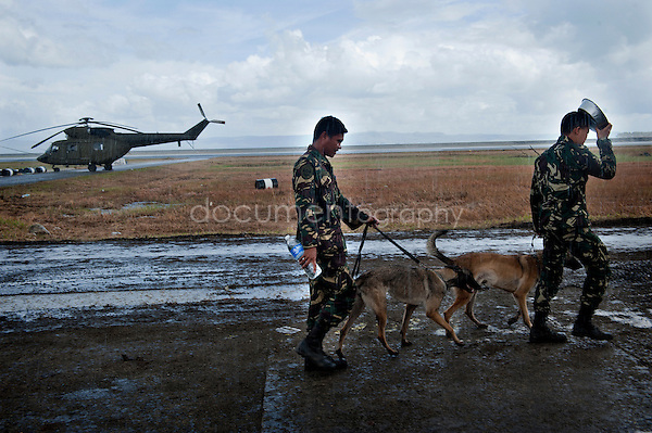 Magali Corouge / Documentography<br />Nov-Dec 2013, Tacloban, Leyte, Philippines.<br /><br />At the airport of Tacloban planes -carrying locals who want to leave the island- are crossing the numerous helicopters that come to drop off supllies to remote villages.