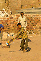 Boy playing cricket, Jodhpur, Rajasthan, India