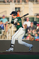 Zach Sullivan (24) of the Greensboro Grasshoppers follows through on his swing against the Kannapolis Intimidators at CMC-Northeast Stadium on August 1, 2015 in Kannapolis, North Carolina.  The Intimidators defeated the Grasshoppers 7-4.  (Brian Westerholt/Four Seam Images)