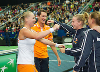 Moskou, Russia, Februari 7, 2016,  Fed Cup Russia-Netherlands, Kiki Bertens (NED) is congratulated by her team membersafter she just put the Netherland in a 3-0 win, lts captain Paul Haarhuis, Richel Hogenkamp and Cindy Burger<br /> Photo: Tennisimages/Henk Koster