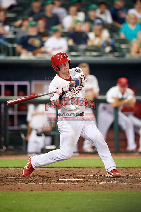 Memphis Redbirds catcher Carson Kelly (19) swings at a pitch during a game against the Round Rock Express on April 28, 2017 at AutoZone Park in Memphis, Tennessee.  Memphis defeated Round Rock 9-1.  (Mike Janes/Four Seam Images)
