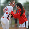 Lisa Fabig #20 of MacArthur, left, during Game 2 of the Nassau County varsity softball Class A final against Island Trees at Mitchel Athletic Complex on Wednesday, May 24, 2017.