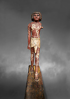 Ancient Egyptian wooden statue,  Middle Kingdom (1980-1700 BC), tomb of Shimes, Asyut. Egyptian Museum, Turin.  Grey background.