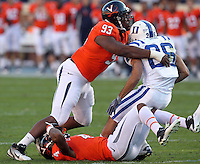 CHARLOTTESVILLE, VA- NOVEMBER 12:  Wide receiver Donovan Varner #26 of the Duke Blue Devils is tackled by safety Rodney McLeod #4 and defensive tackle Will Hill #93 of the Virginia Cavaliers during the game on November 12, 2011 at Scott Stadium in Charlottesville, Virginia. Virginia defeated Duke 31-21. (Photo by Andrew Shurtleff/Getty Images) *** Local Caption *** Rodney McLeod;Will Hill;Donovan Varner