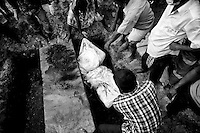 Unidentified bodies found inside the Rana Plaza rubble are buried in the Juraiun graveyard in Dhaka, Bangladesh