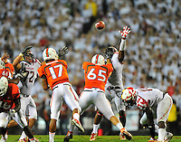 QB Stephen Morris of the Hurricanes throws downfield against the Terrapin defenders. Maryland defeated Miami 32-24 during a game at the Byrd Stadium in College Park, MD on Monday, September 5, 2011. Alan P. Santos/DC Sports Box