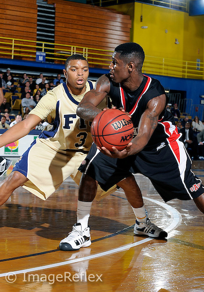 Florida International University men's basketball guard Tremayne Russell (3) plays against Arkansas State University.  FIU won the game 80-76 in overtime on February 07, 2009 at Miami, Florida. .