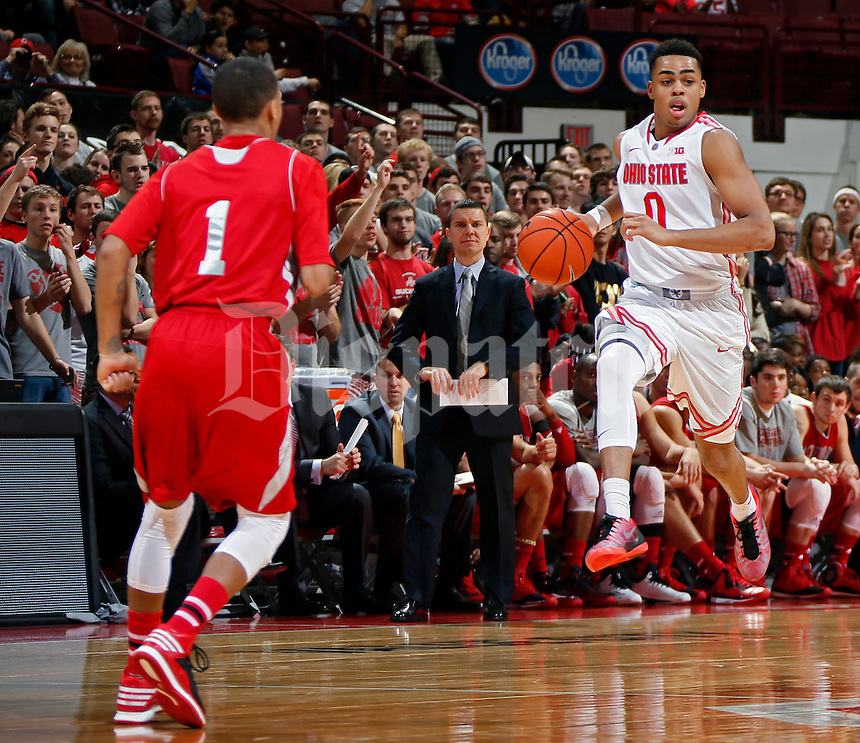 Ohio State Buckeyes guard D'Angelo Russell (0) pushes the tempo against Sacred Heart Pioneers guard Cane Broome (1) during the 2nd half of their NCAA game at Value City Arena in Columbus, Ohio on November 23, 2014.  (Dispatch photo by Kyle Robertson)