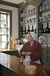 A period actor explains the functions of the apothecary at the Pasteur & Galt Apothecary Shop at Colonial Williamsburg, Virginia.  In colonial times, the apothecary acted as both doctor and pharmacist, providing medical treatment, prescribing medicine, performing surgery, and acting as a midwife.