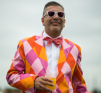 BALTIMORE, MD - MAY 20: A colorfully dressed man wears a breast cancer awareness pin as he walks in the infield on Preakness Stakes Day at Pimlico Race Course on May 20, 2017 in Baltimore, Maryland.(Photo by Scott Serio/Eclipse Sportswire/Getty Images)