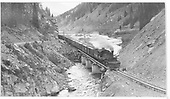 RGS K-27 #461 with pilot snowplow heading down from Lizard Head Pass crossing bridge 64-A into Burns Canyon.<br /> RGS  Burns Canyon, CO  Taken by Perry, Otto C. - 6/26/1945