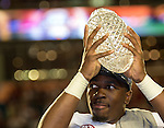 Defensive MVP, Alabama's C.J. Mosley hoist the BCS National Championship crystal football after defeating Notre Dame 42-14 at Sun Life Stadium in Miami on January 7, 2013.  <br />