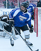 Stefan Demopoulos (PC - 12) -  - The participating teams in Hockey East's first doubleheader during Frozen Fenway practiced on January 3, 2014 at Fenway Park in Boston, Massachusetts.
