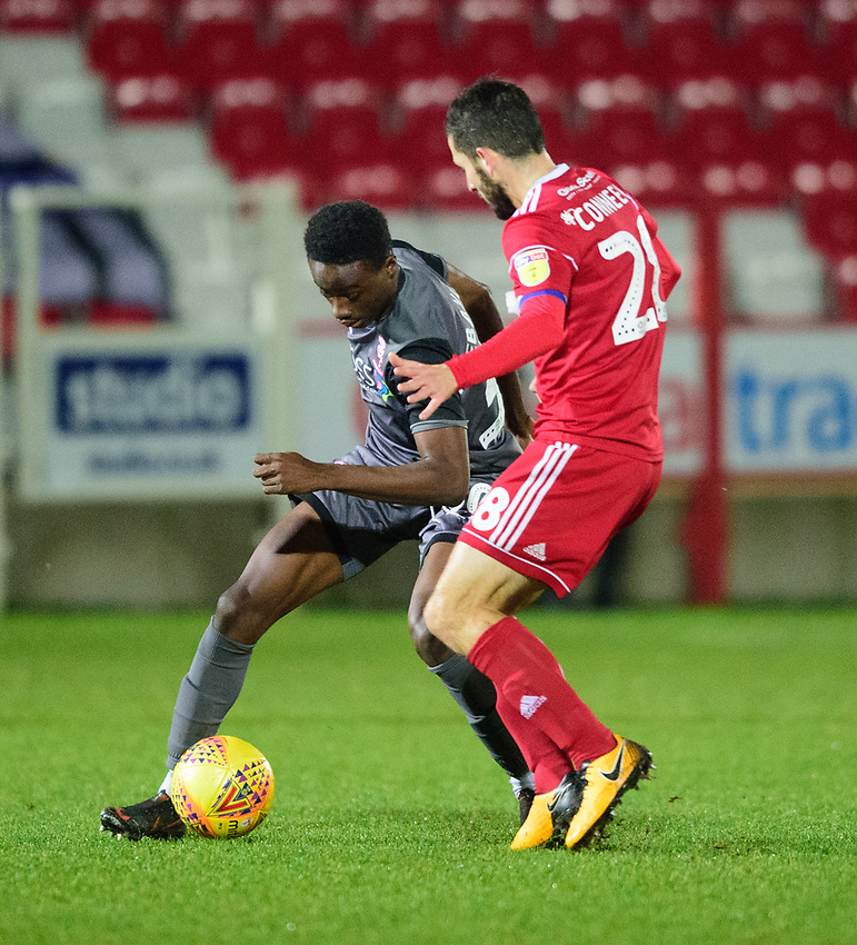 Lincoln City's Jordan Adebayo-Smith vies for possession with Accrington Stanley's Seamus Conneely<br /> <br /> Photographer Andrew Vaughan/CameraSport<br /> <br /> The EFL Checkatrade Trophy Second Round - Accrington Stanley v Lincoln City - Crown Ground - Accrington<br />  <br /> World Copyright © 2018 CameraSport. All rights reserved. 43 Linden Ave. Countesthorpe. Leicester. England. LE8 5PG - Tel: +44 (0) 116 277 4147 - admin@camerasport.com - www.camerasport.com