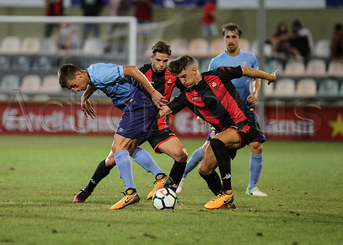 August 12th 2017, Reus, Catalonia, Spain; Pre-season friendly football, Reus Deportiu versus Girona; Pere Pons tackled by a Reus player
