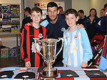 Robert and Hugh Murphy pictured with Drogheda United's Gavin Brennan and the EA cup at the Drog Shop in Scotch hall. Photo: Colin Bell/pressphotos.ie