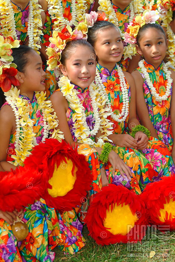 The children or 'keiki' from Halau Hula O Hokulani at the Lei Day Festivities at the Kapiolani Park Bandstand at Waikiki, Honolulu, Hawaii