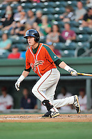 Center fielder Ryan Aper (23) of the Greensboro Grasshoppers bats in a game against the Greenville Drive on Thursday, August 27, 2015, at Fluor Field at the West End in Greenville, South Carolina. Greenville won, 10-2.  (Tom Priddy/Four Seam Images)
