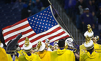 The American flag leaves the tunnel during Salute to Armed Services Night.