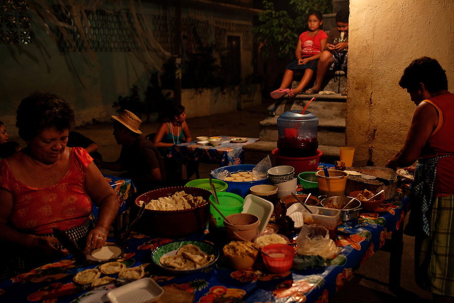 Las Lomas, , Mexico, February 19, 2012 - Women prepare hand made tacos at small family restaurant set up on the steps of an alley in the village of Las Lomas.