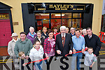 RED TAPE: Cllr Johnny Wall cuts the tape to officially open Hayley's Hair Salon, Listowel on Friday with Hayley and Kieran Evans    Copyright Kerry's Eye 2008