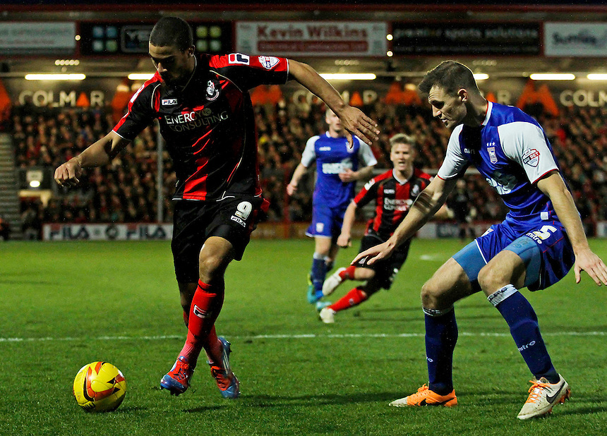 Bournemouth's Lewis Grabban shields the ball from Ipswich Town's Tommy Smith. <br /> <br /> Photo by James Marsh/CameraSport<br /> <br /> Football - The Football League Sky Bet Championship - AFC Bournemouth v Ipswich Town - Sunday 29th December 2013 - Goldsands Stadium - Bournemouth<br /> <br /> &copy; CameraSport - 43 Linden Ave. Countesthorpe. Leicester. England. LE8 5PG - Tel: +44 (0) 116 277 4147 - admin@camerasport.com - www.camerasport.com
