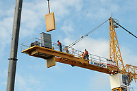NWA Arkansas Democrat-Gazette/DAVID GOTTSCHALK  Workers continue to dismantle Thursday, September 13, 2018, a tower crane at the TheatreSquared construction site in Fayetteville. Baldwin and Shell Construction was approved for a temporary road closure permit of West Spring Street Thursday and today from 8:00 a.m. to 5:00 p.m. for the removal. Designed by Marvel Architects and Charcoalblue, the 50,000-square-foot building will feature two theaters, a rehearsal space, offices, education and community space, on-site design and building workshops, eight guest artist apartments, three levels of outdoor public spaces and a cafe and bar that will remain open during the day. TheatreSquared organizers hope to open in time for the 2019-2020 season.