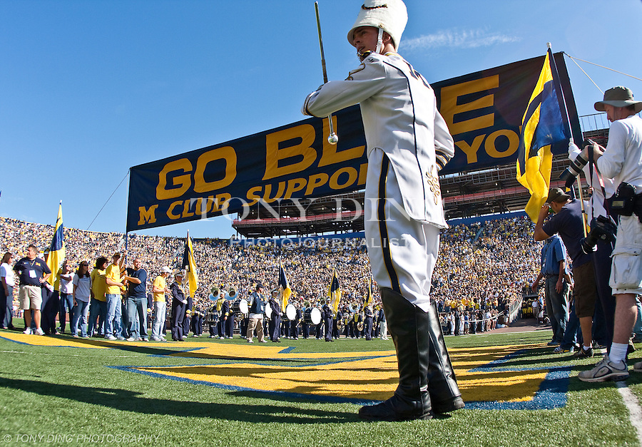 "11 October 2008: The Michigan Marching Band drum major prepares to signal for the Michigan football team to take the field under the ""Go Blue"" banner, before an NCAA college football game between the Michigan Wolverines and Toledo, at Michigan Stadium in Ann Arbor, Michigan."