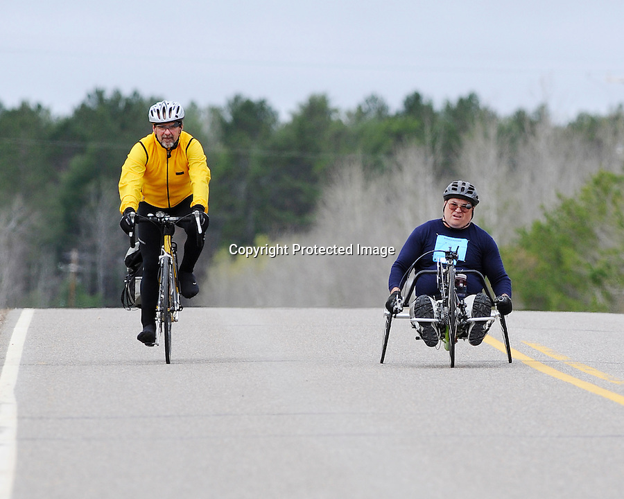 Paced by a race official, Dean Juntunen competes in the annual Journey's Marathon, Eagle River, WI, Saturday, May 9, 2009. The Mass City, MI man won the wheelchair division in a time of 02:10.05.