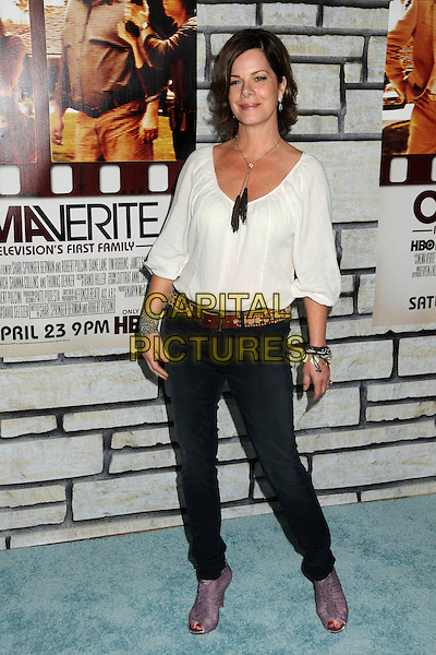 """MARCIA GAY HARDEN .HBO Films' """"Cinema Verite"""" Los Angeles Premiere held at Paramount Studios, Los Angeles, California, USA,.11th April 2011..full length top jeans belt purple open toe shoes peep ankle boots bracelets  tassels  necklace white top  .CAP/ADM/BP.©Byron Purvis/AdMedia/Capital Pictures."""