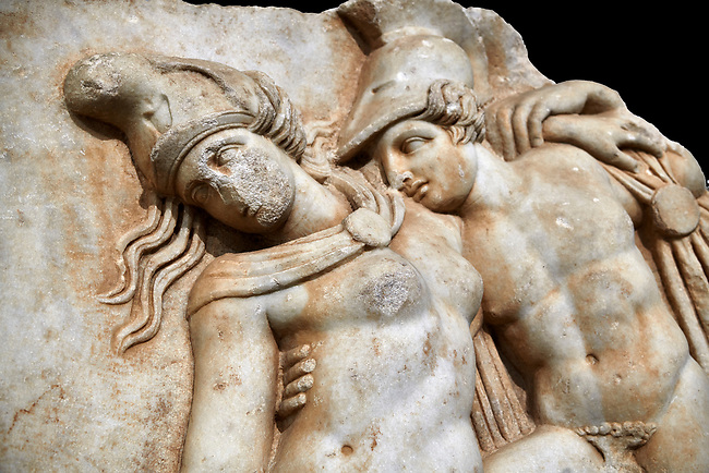 Detail of a Roman Sebasteion relief sculpture of Achilles and a dying Amazon, Aphrodisias Museum, Aphrodisias, Turkey.     Against a black background.<br /> <br /> Achilles supports the dying Amazon queen Penthesilea whom he has mortally wounded. Her double headed axe slips from her hands. The queen had come to fight against the Greeks in the Trojan war and Achilles fell in love with her.