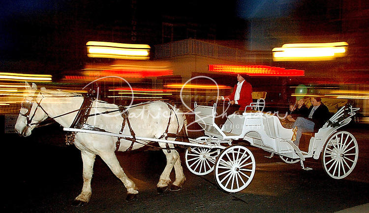 A horse and carriage carry riders during the annual Christmas tree lighting event at Birkdale Village in Huntersville, NC. Birkdale Village combines the best of shopping, dining, apartments and entertainment venues within a 52-acre mixed-use development.