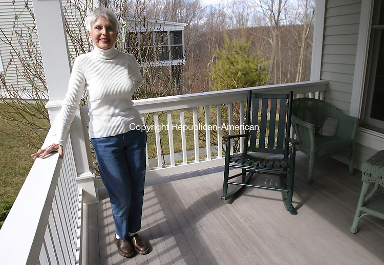MIDDLEBURY, CT 4/9/07- 040907BZ01- Cancer survivor  Jo Tragakiss poses on the porch of her Middlebury home Monday afternoon.<br /> Jamison C. Bazinet Republican-American