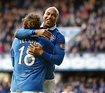 El Hadji Diouf celebrates with Nikica Jelavic