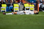 Cristiano Ronaldo of Real Madrid lies on the pitch after clashing with Adam Hlousek of Legia Warszawa during the 2016-17 UEFA Champions League match between Real Madrid and Legia Warszawa at the Santiago Bernabeu Stadium on 18 October 2016 in Madrid, Spain. Photo by Diego Gonzalez Souto / Power Sport Images