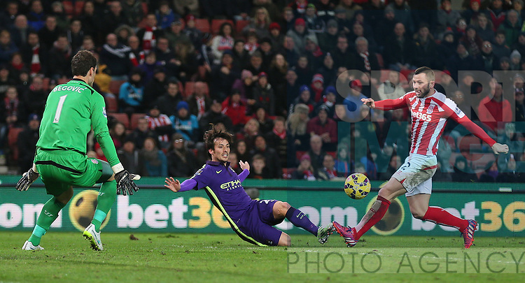 David Silva of Manchester City crosses the ball for Sergio Aguero of Manchester City to score only for it to be disallowed - Barclays Premier League - Stoke City vs Manchester City - Britannia Stadium - Stoke on Trent - England - 11th February 2015 - Picture Simon Bellis/Sportimage